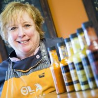 Donna Chevrier, owner of Ola Cocina, poses with some of her very hot, hot sauces in her Ottawa mexican restaurant Friday, November 7, 2014. (Darren Brown/Ottawa Citizen)